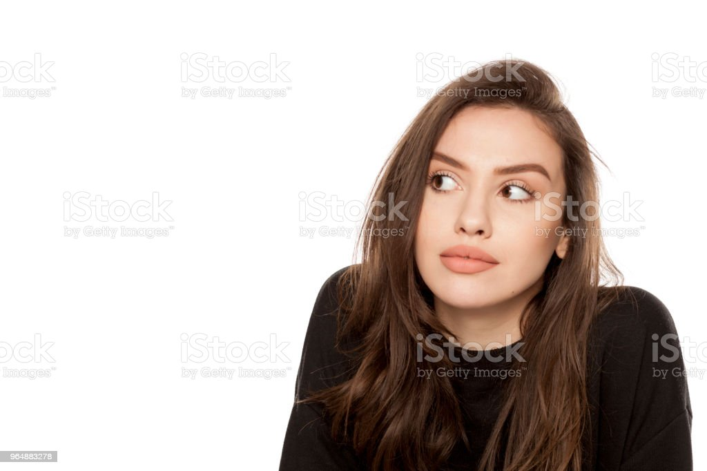 Portrait of beautiful young woman looking aside on white background royalty-free stock photo