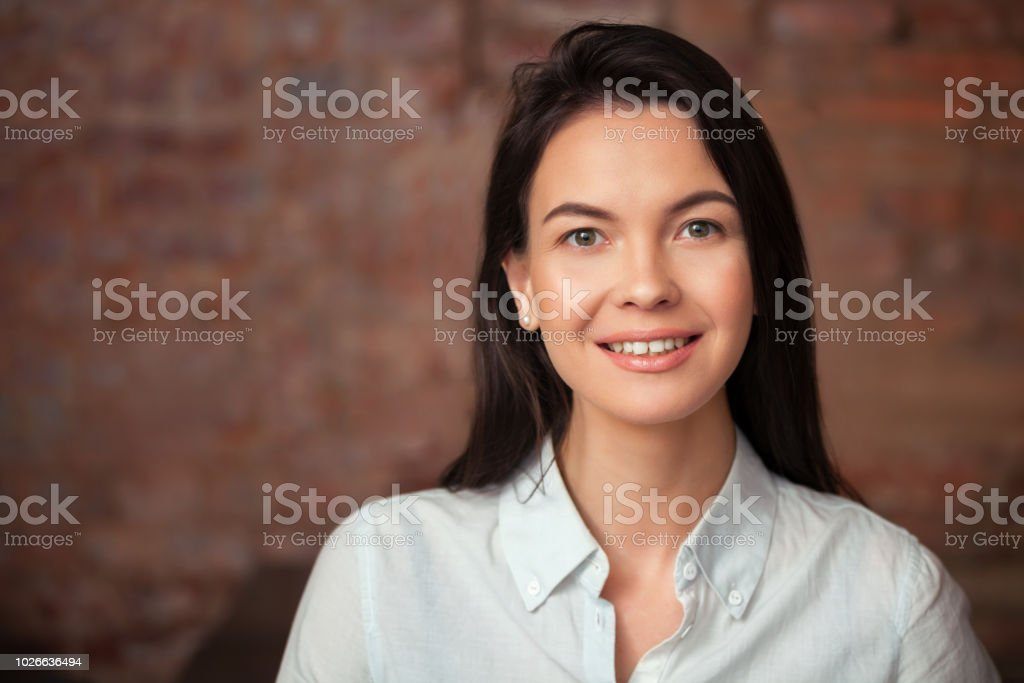 Portrait of beautiful young woman looking happy. stock photo