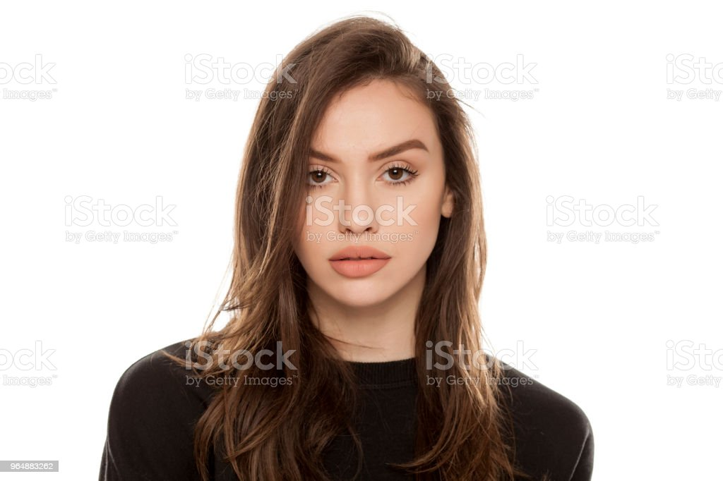 Portrait of beautiful young woman looking in camera on white background royalty-free stock photo