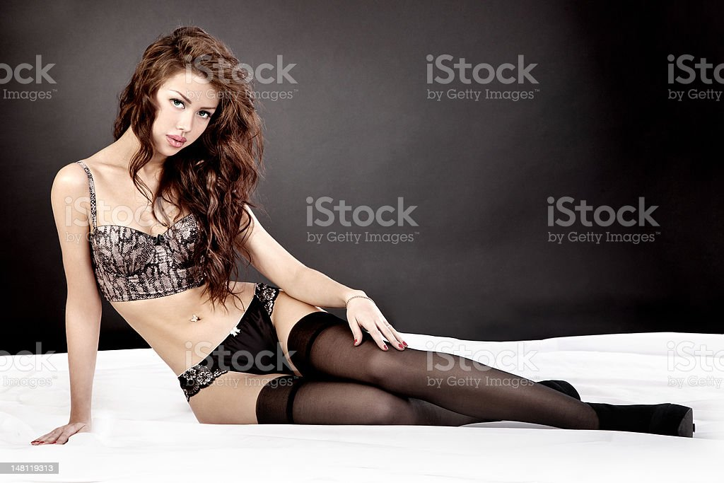Portrait of beautiful young woman lying in bed royalty-free stock photo
