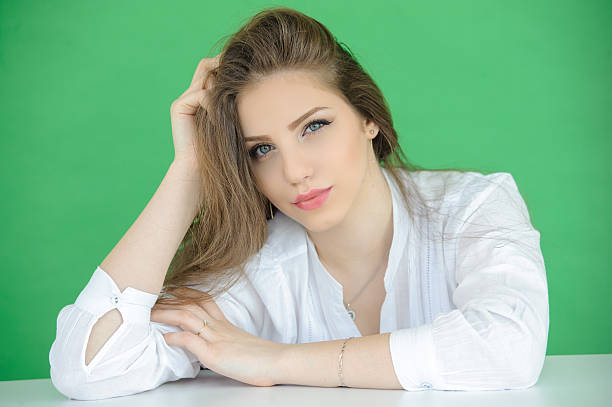 portrait of beautiful young woman over green screen background stock photo