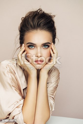 istock Portrait of beautiful young woman 876959074