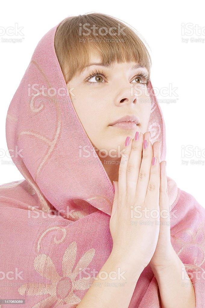 Portrait of beautiful young woman praying royalty-free stock photo