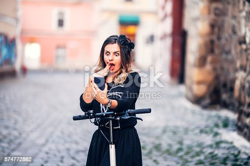 874772840istockphoto Portrait of beautiful young woman taking pictures of herself with smartphone. Taking selfies and making faces 874772862