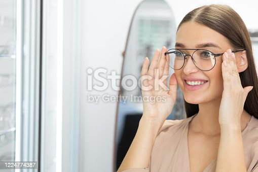 istock Portrait of beautiful young woman wearing spectacles 1224774387
