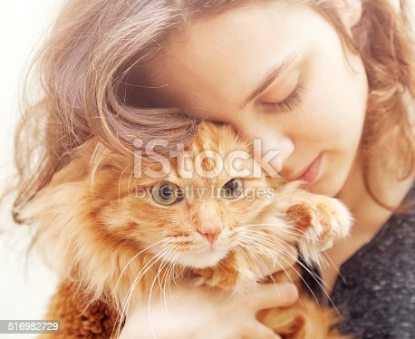 istock portrait of beautiful young woman with a cat 516982729