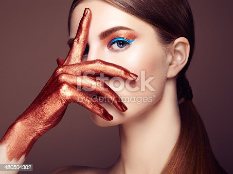 istock Portrait of beautiful young woman with art make-up 480504302
