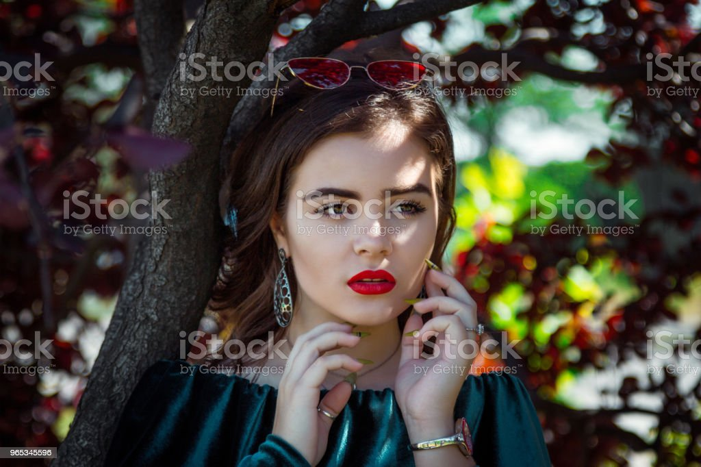 Portrait of beautiful young woman with bright makeup zbiór zdjęć royalty-free