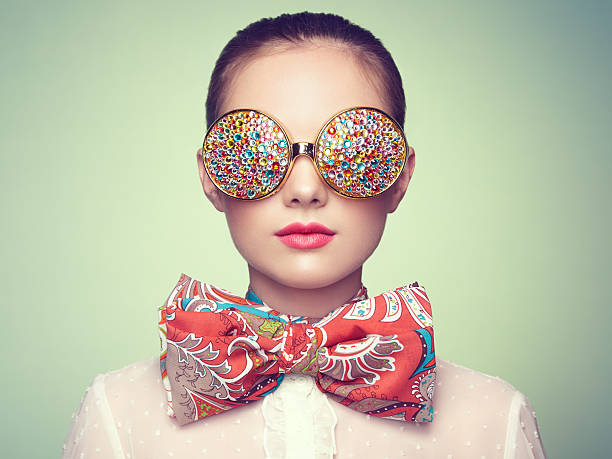 portrait of beautiful young woman with colored glasses - funky stock pictures, royalty-free photos & images