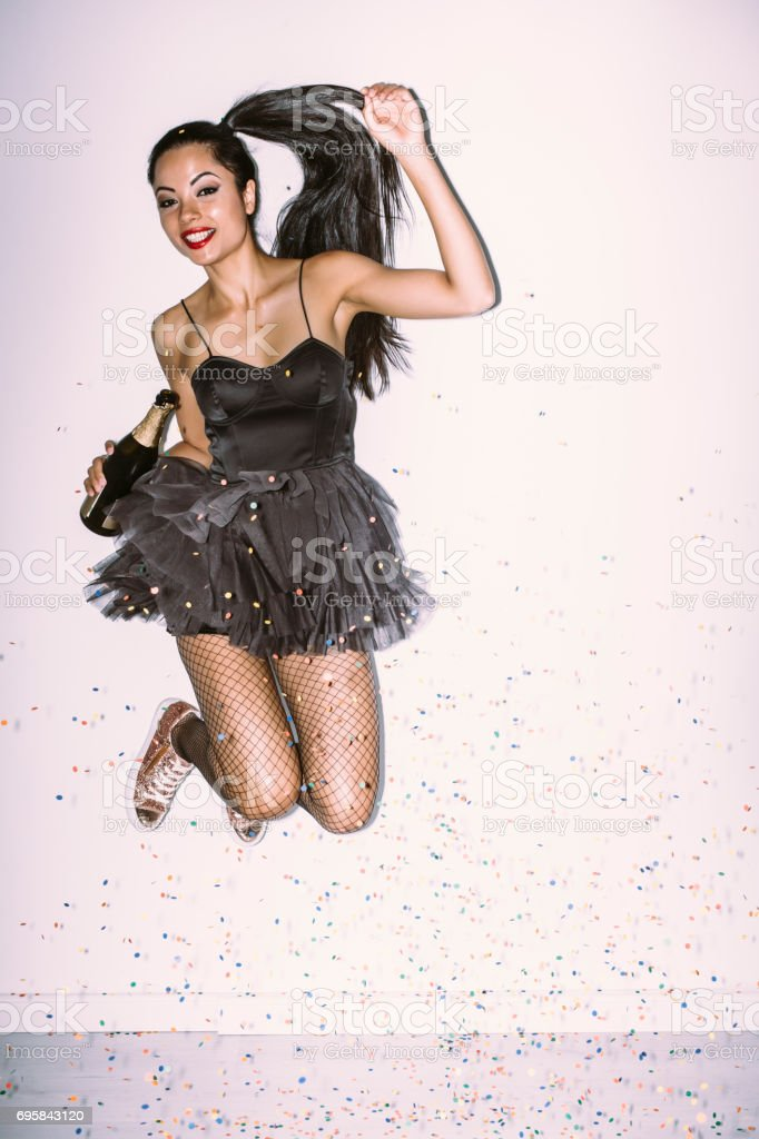 Portrait of beautiful young woman with disco ball stock photo