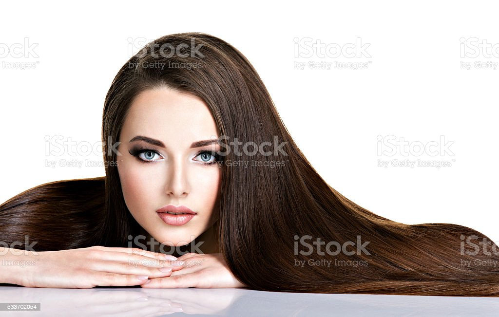 Portrait of beautiful young woman with long straight brown hair stock photo