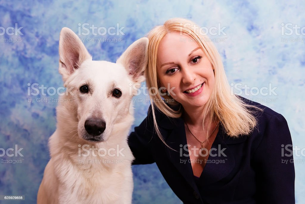Portrait of beautiful young woman with white dog stock photo