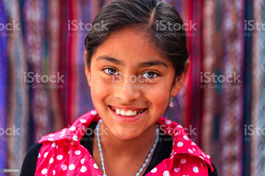 Portrait of beauty Peruvian girl in Pisac, The Sacred Valley stock photo