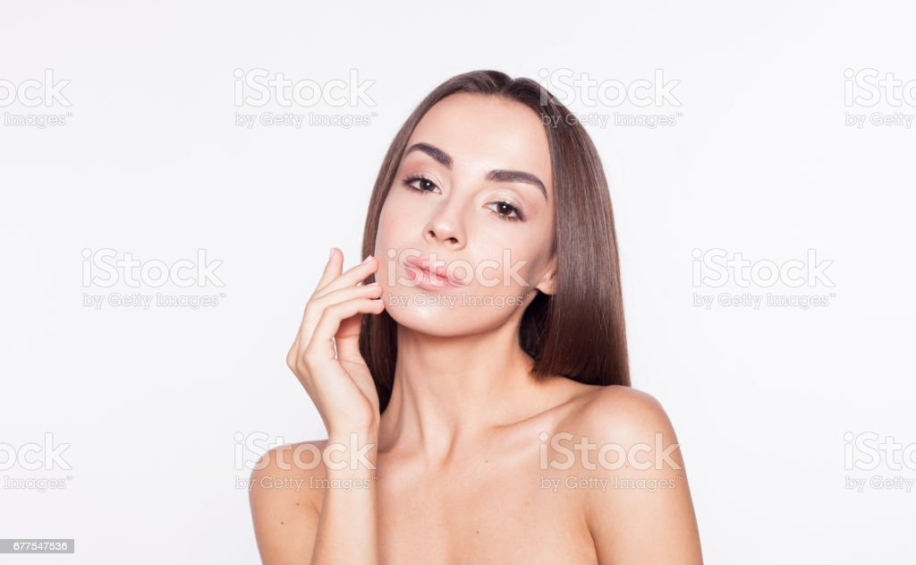 Portrait of Beauty Woman face with perfect skin. Isolated on white. royalty-free stock photo