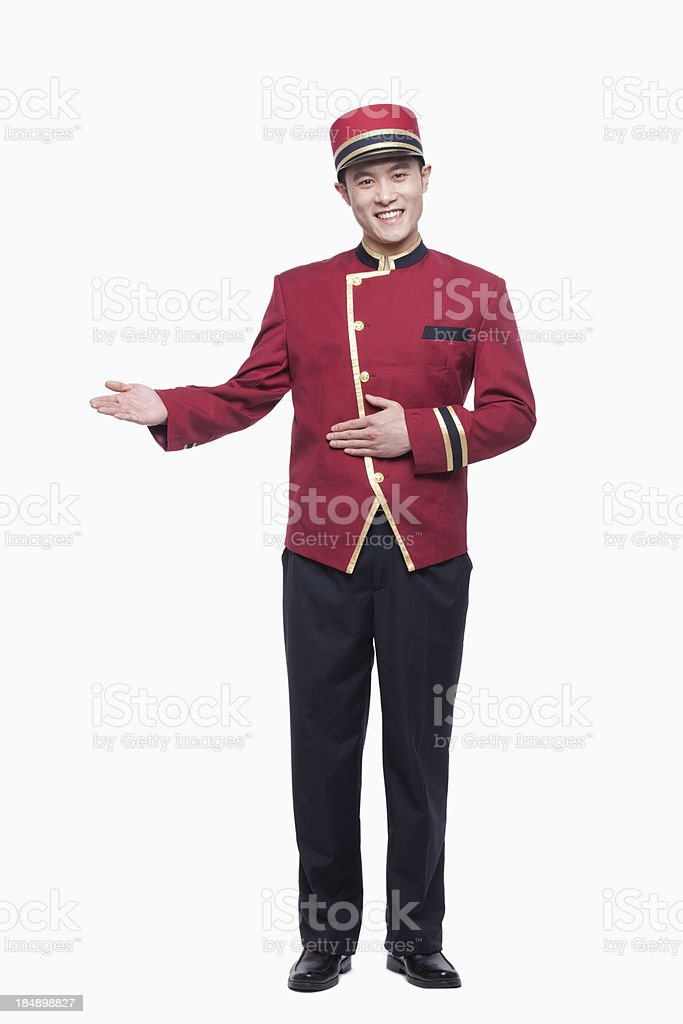 Portrait of Bellhop, Greeting, studio shot stock photo