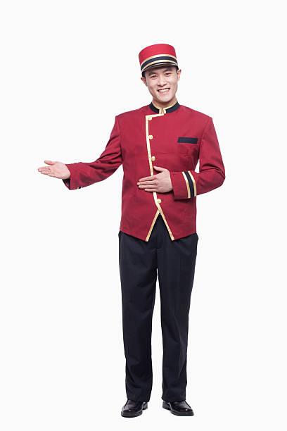 Portrait of Bellhop, Greeting, studio shot stock photo