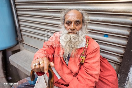 Dhaka / Bangladesh - January 14, 2019: Portrait of Bengali man with long white beard in the streets of Old Dhaka