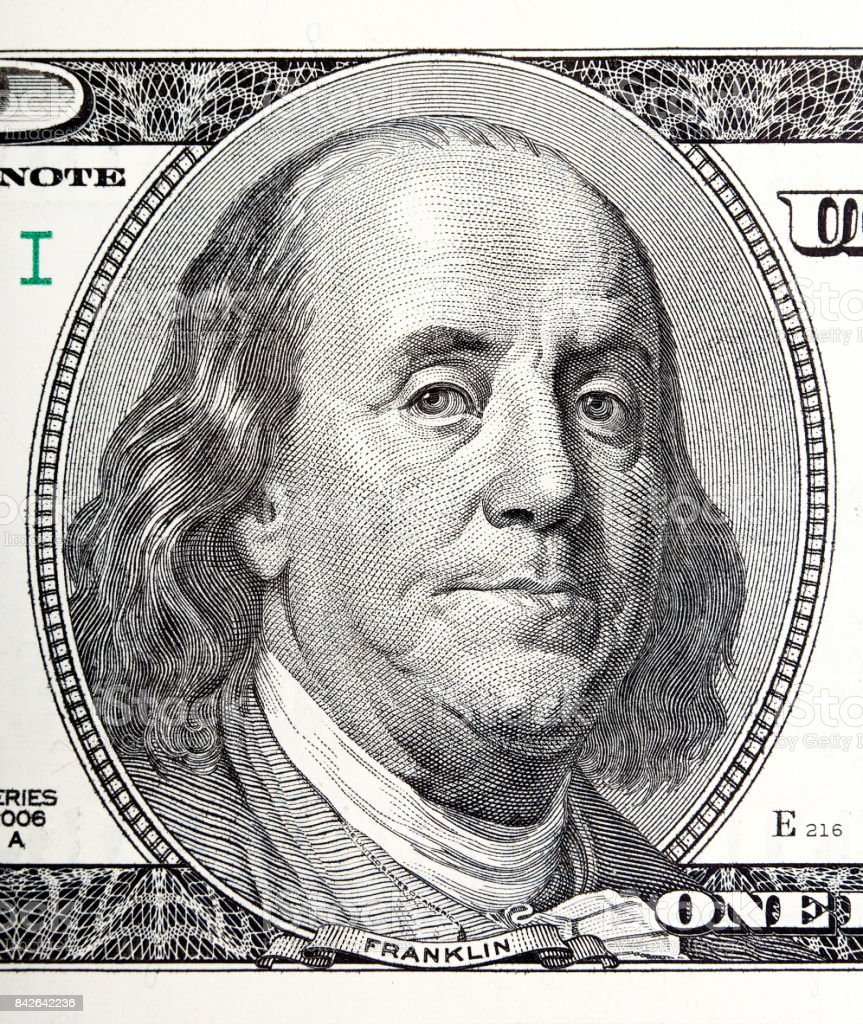 Portrait of Benjamin Franklin macro from 100 dollars bill stock photo