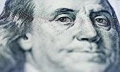 istock Portrait of Benjamin Franklin on one hundred dollar bill 1058201242