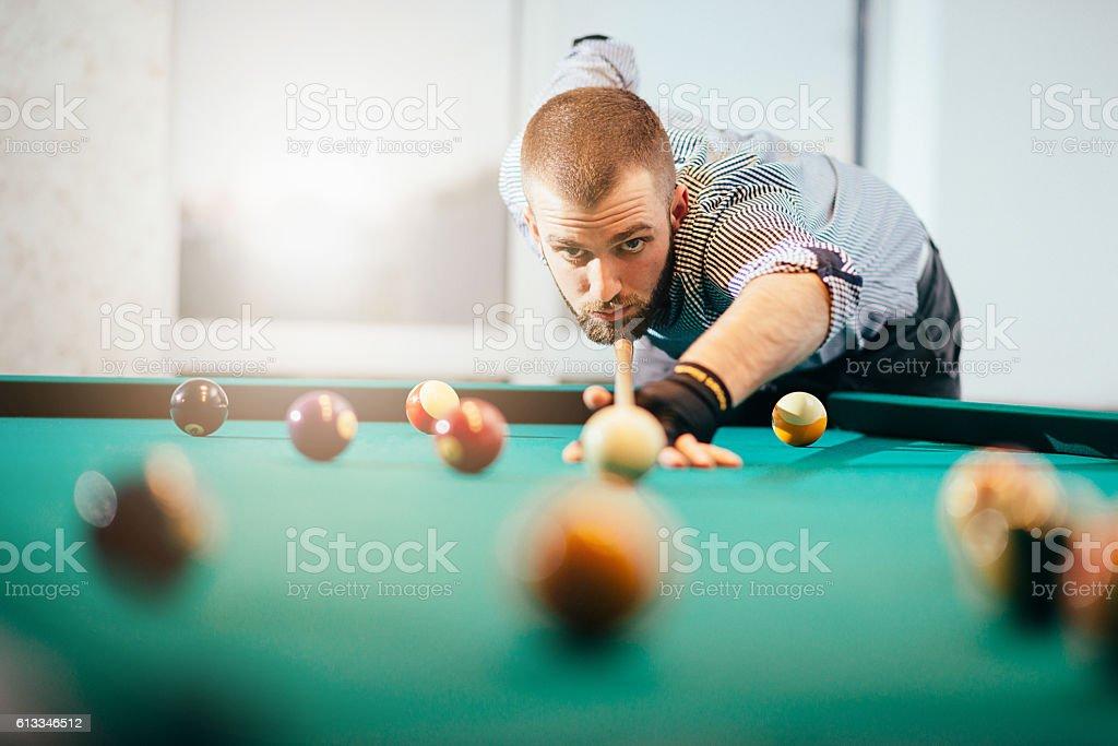 Portrait of billiard player aiming stock photo