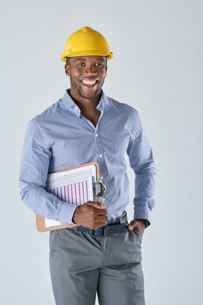 Portrait of black architect with a clipboard under his arm stock photo
