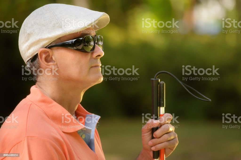 Portrait Of Blind Man Sitting In City Park'n stock photo
