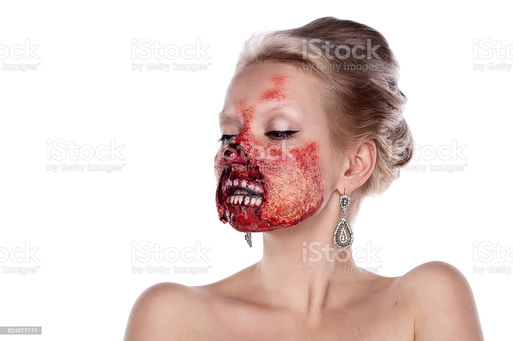 Portrait of blond bloody zombies in  festive makeup, isolated on stock photo
