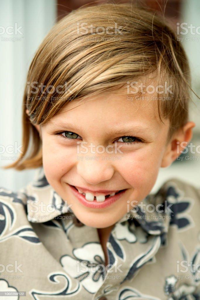 Portrait of blond preteen boy outdoors in summer. stock photo