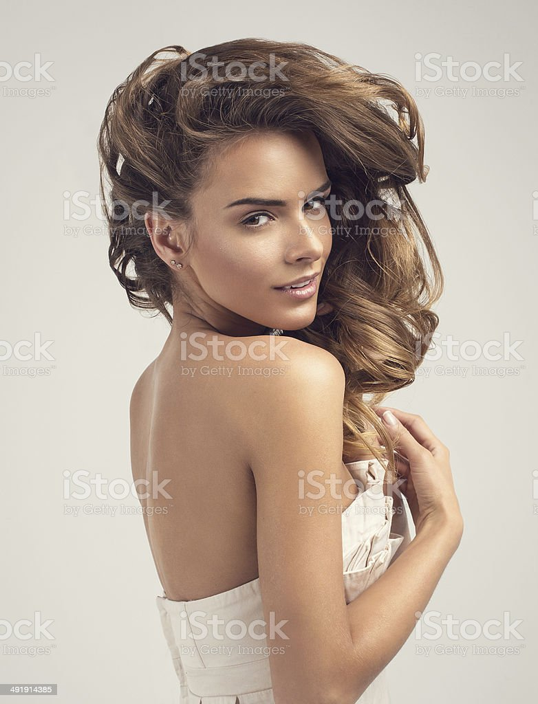 Portrait of blond smiling woman on white background stock photo