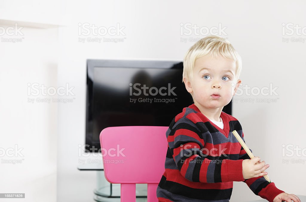 Portrait Of Blonde Caucasian Toddler Drawing In The Living Room royalty-free stock photo
