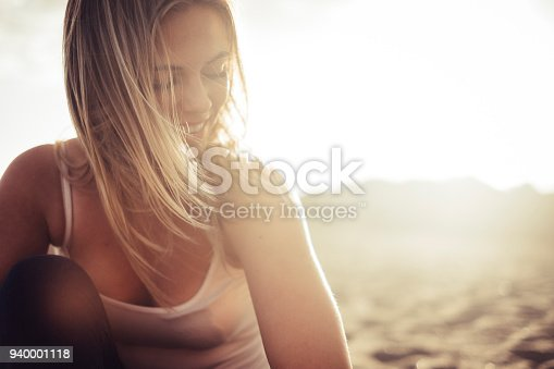 istock portrait of blonde girl with backlight 940001118