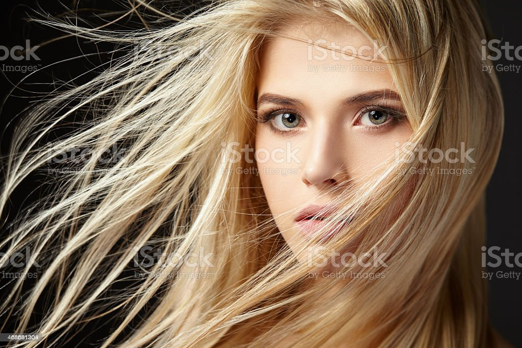 Portrait of blonde girl with fluttering hair stock photo