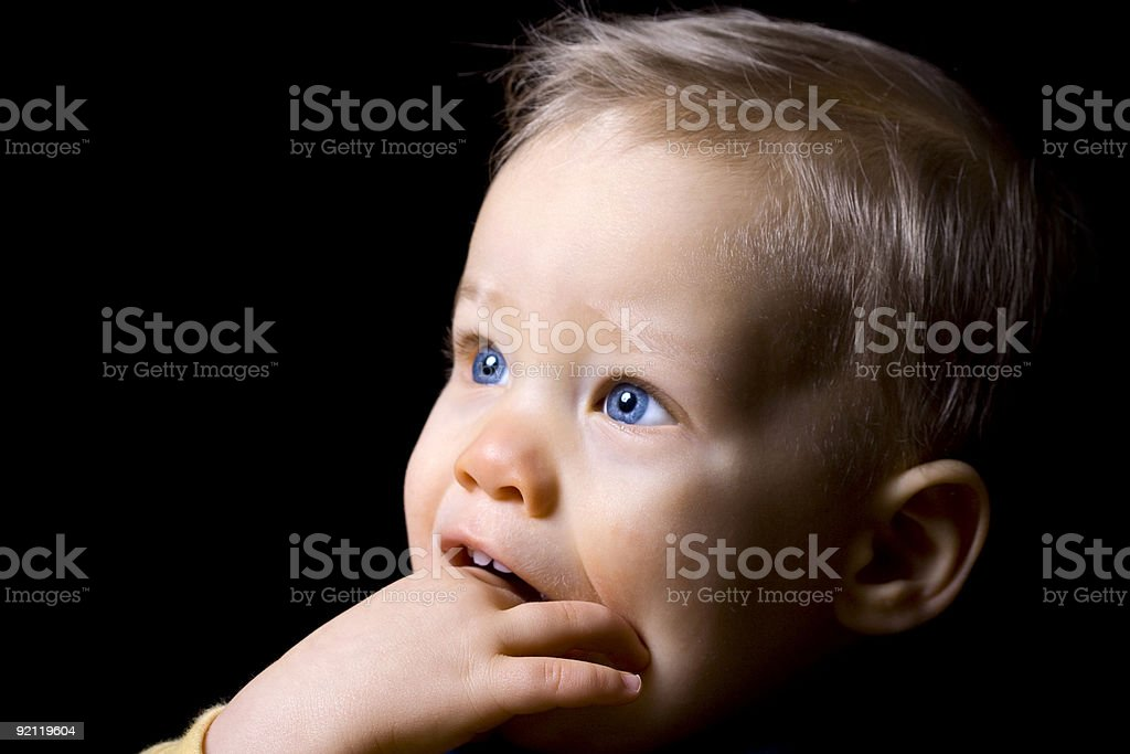 Portrait of blonde male infant with his fingers in his mouth royalty-free stock photo