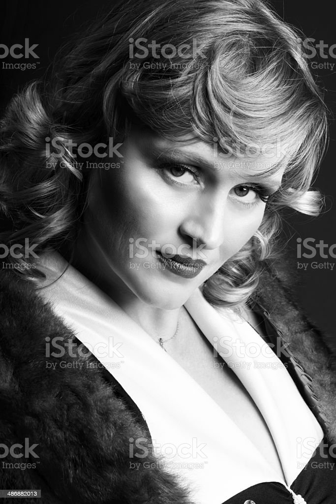 B&W portrait of blonde with head tilted. royalty-free stock photo