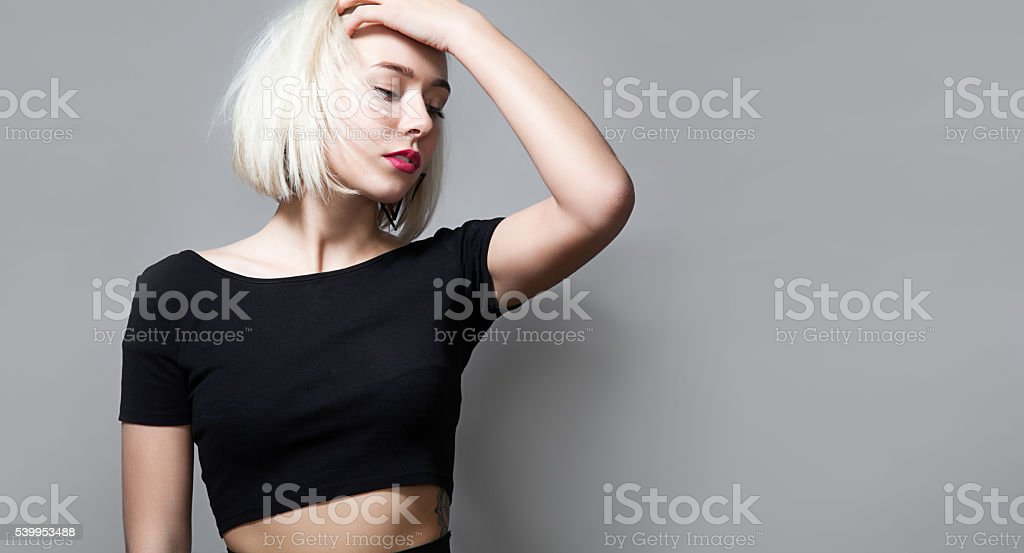 Portrait of blonde woman with closed eyes and red lipsti stock photo