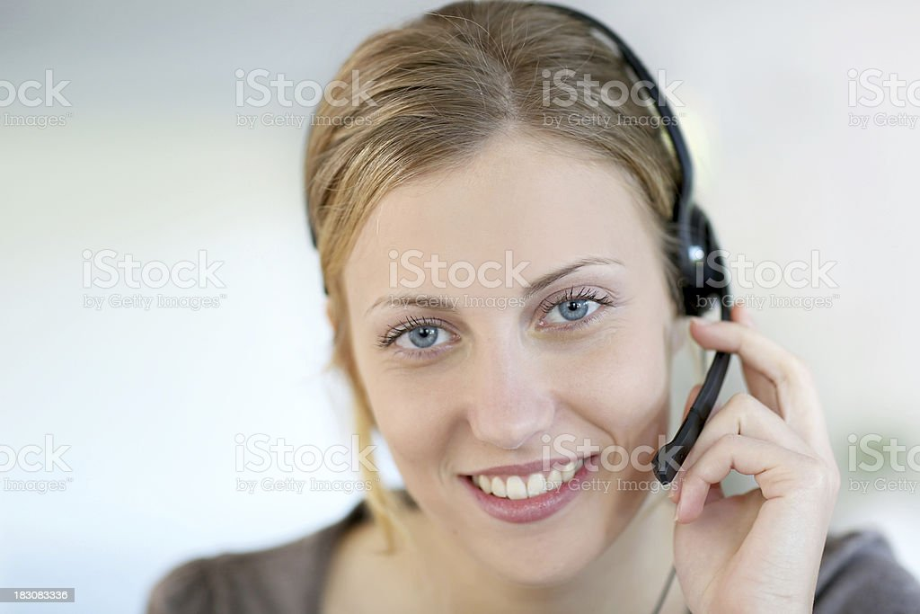 Portrait of blonde woman with headset for work stock photo