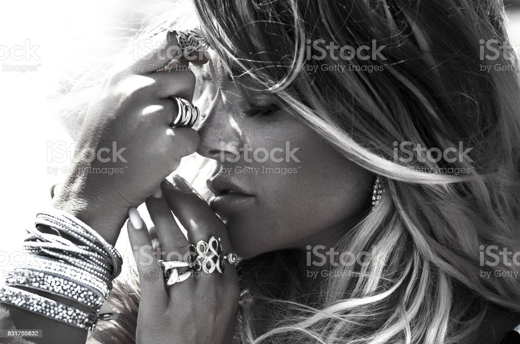 Portrait of blonde woman with jewelry. stock photo