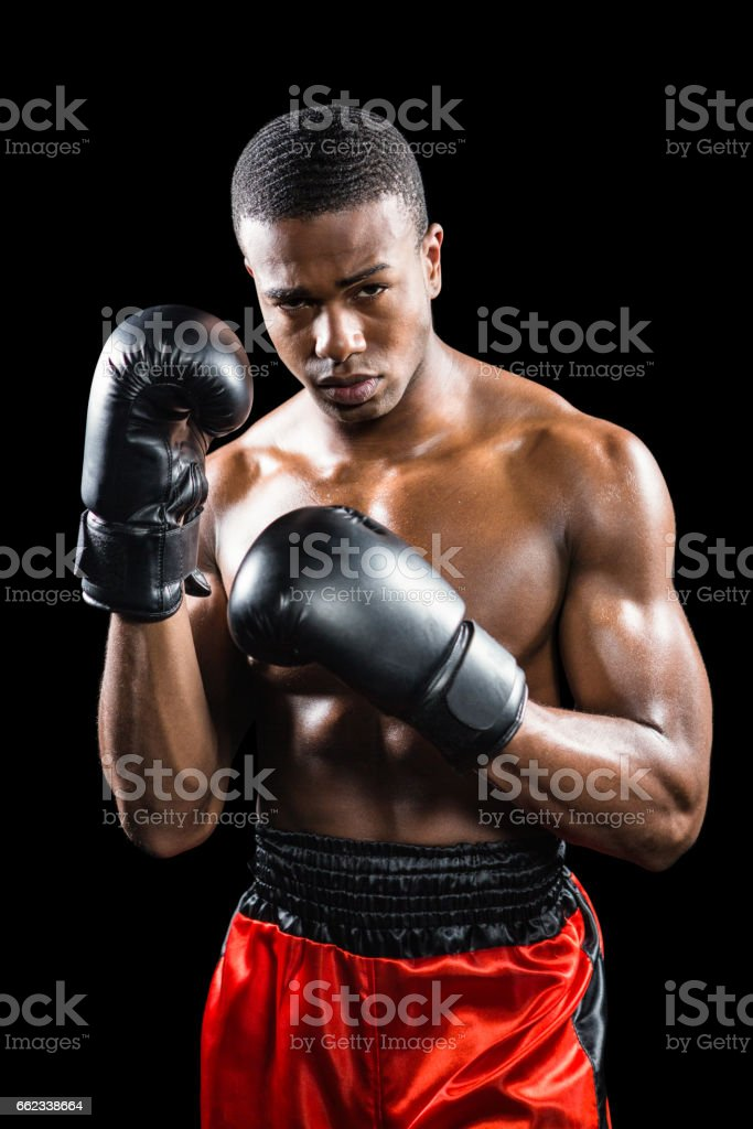 Portrait of boxer performing uppercut stock photo