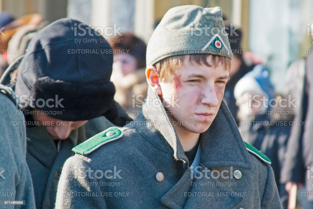 Portrait of boy dressed as German soldier of World War II in reconstruction of the capture of field Marshal Paulus in Volgograd. stock photo
