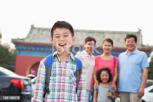 972962180 istock photo Portrait of boy with his family in the background 186198978