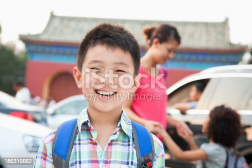 972962180 istock photo Portrait of boy with his family in the background 186319662