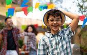 istock Portrait of boy with straw hat at Festa Junina 1320079821