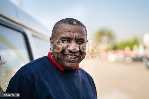 635967404 istock photo Portrait of Brazilian Man at Work 999615018