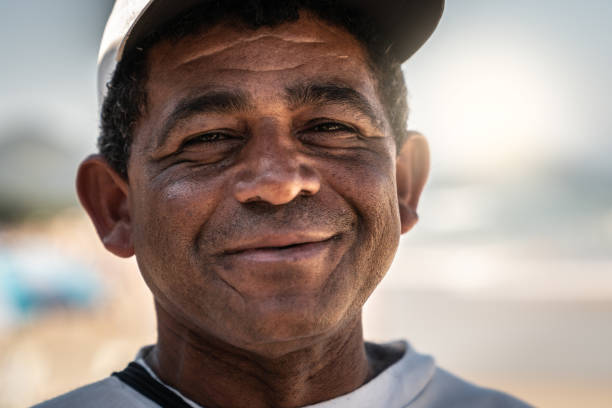 Portrait of Brazilian Mature Men at the beach stock photo
