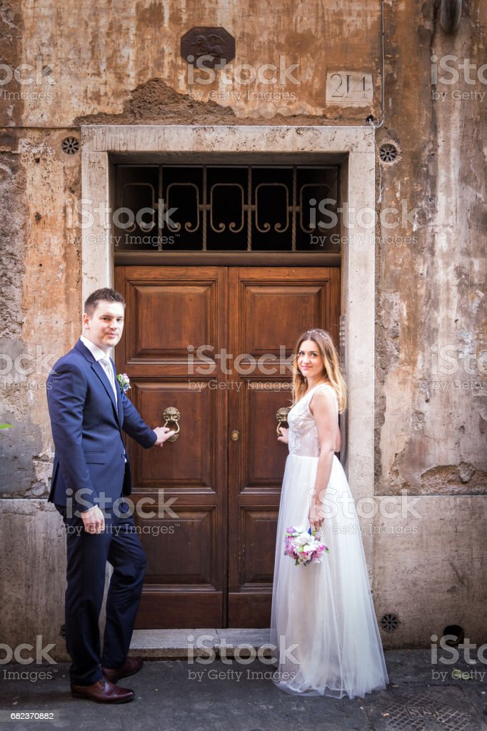 Portrait of bride and groom posing on the streets of Rome, Italy zbiór zdjęć royalty-free