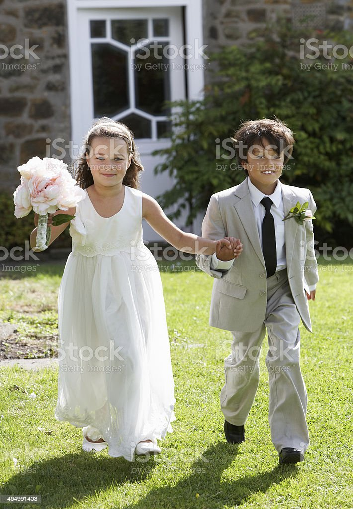 Portrait Of Bridesmaid With Page Boy stock photo