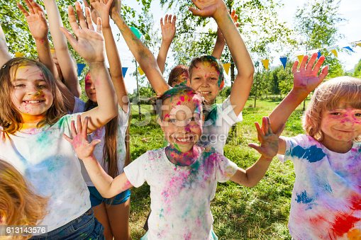 istock Portrait of bright kids smeared in colored powder 613143576