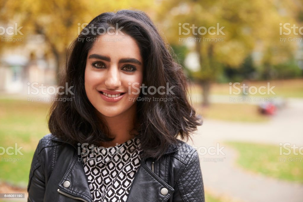 Portrait Of British Muslim Woman In Urban Park royalty-free stock photo