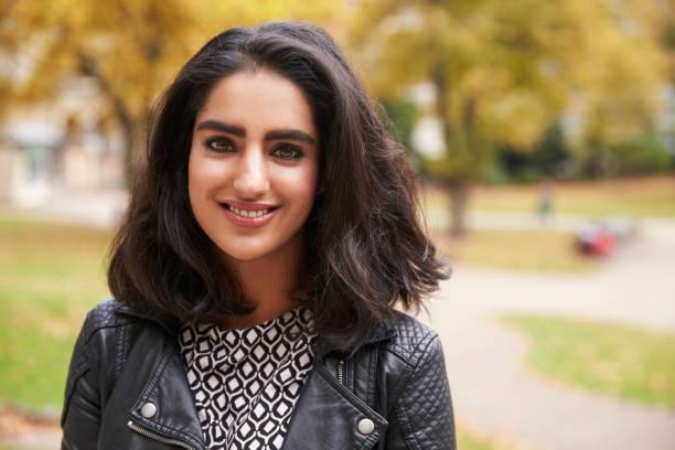portrait of british muslim woman in urban park - femme arabe photos et images de collection