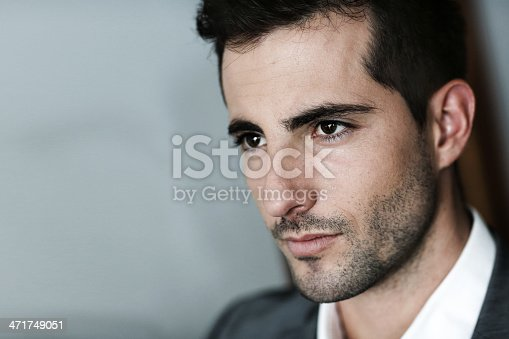 istock Portrait of brown man with black eyes 471749051